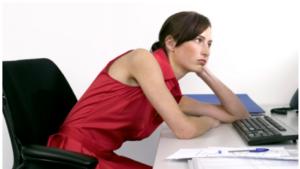 Woman slumped over at desk