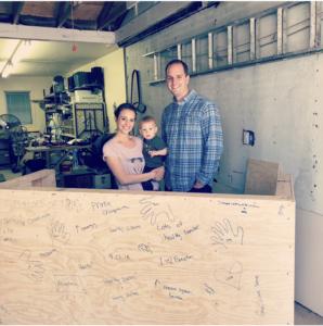 Dr. Matt and Dr. Lauren standing behind their unfinished front desk