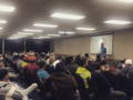 good chiropractor speaking to large audience